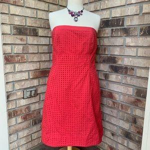 Pink strapless eyelet dress